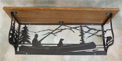 metal, art, shelf, wood, trees, mountains, fish, boat, fishing pole, dog canoe, paddles, water, lake, fishing line
